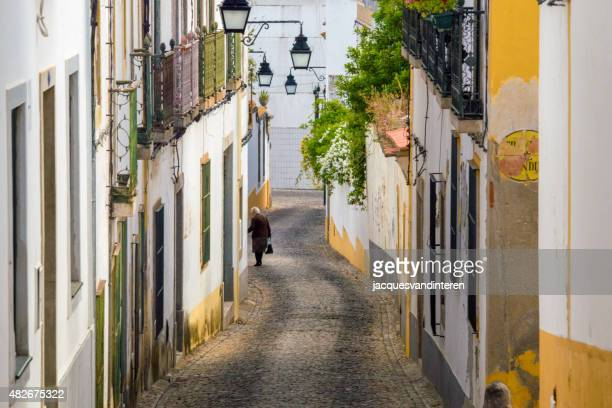 Hilly street in Evora, Portugal
