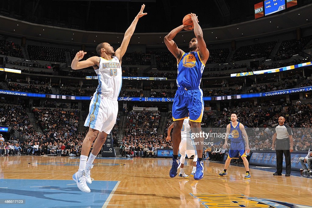 Hilton Armstrong #57 of the Golden State Warriors shoots against the Denver Nuggets on April 16, 2014 at the Pepsi Center in Denver, Colorado.
