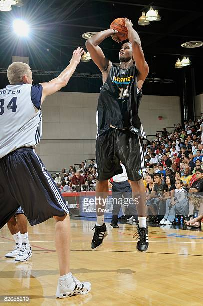 Hilton Armstrong of the New Orleans Hornets shoots a jumper against Brian Butch of the Memphis Grizzles during the game at the NBA Summer League...