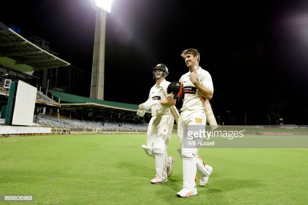 Hilton Cartwright and Mitchell Marsh of the Warriors leave the field at the dinner break during day one of the Sheffield Shield match between Western...