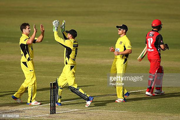 Hilton Cartwright and Sam Whiteman of the Warriors celebrate the wicket of Callum Ferguson of the Redbacks during the Matador BBQs One Day Cup match...