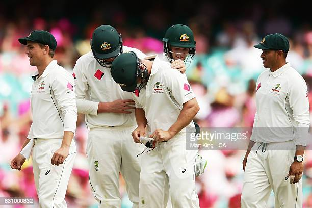 Hilton Cartwright of Australia is surrounded by his team after he was hit in the groin while fielding during day three of the Third Test match...