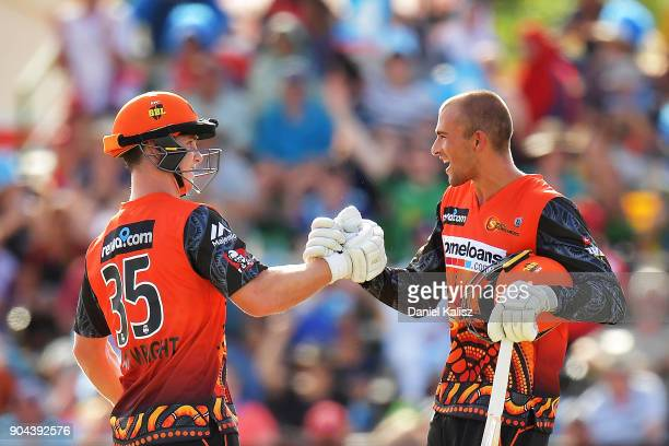 Hilton Cartwright of the Perth Scorchers and Ashton Agar of the Perth Scorchers celebrate after defeating the Strikers during the Big Bash League...