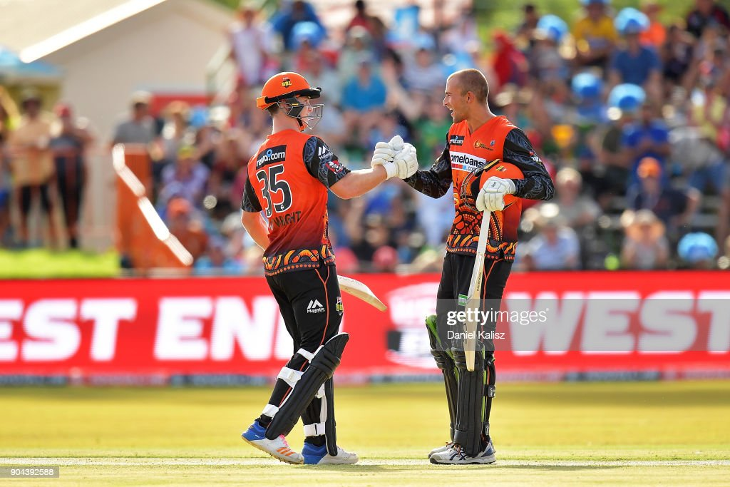 Hilton Cartwright of the Perth Scorchers and Ashton Agar of the Perth Scorchers celebrate after defeating the Strikers during the Big Bash League match between the Adelaide Strikers and the Perth Scorchers at Traeger Park on January 13, 2018 in Alice Springs, Australia.