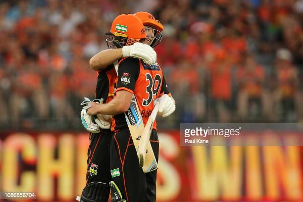Hilton Cartwright of the Scorchers embraces Will Bosisto after winning the Big Bash League match between the Perth Scorchers and the Adelaide...