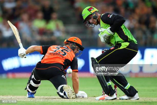 Hilton Cartwright of the Scorchers is dropped by Jay Lenton of the Thunder off a delivery by team mate Farad Ahmed during the Big Bash League match...