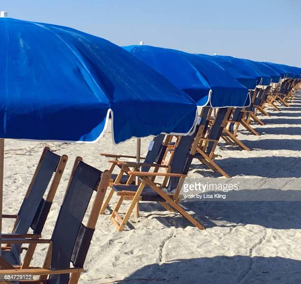 hilton head island beach, umbrellas and chairs - hilton head stock pictures, royalty-free photos & images
