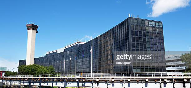 hilton hotel and control tower  at ohare airport, chicago - ohare airport stock pictures, royalty-free photos & images
