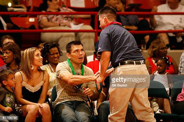 Hilton Koch Owner of the Houston Comets greets Olympic boxer Raul Marquez at Reliant Arena on June 28, 2008 in Houston, Texas. NOTE TO USER: User...