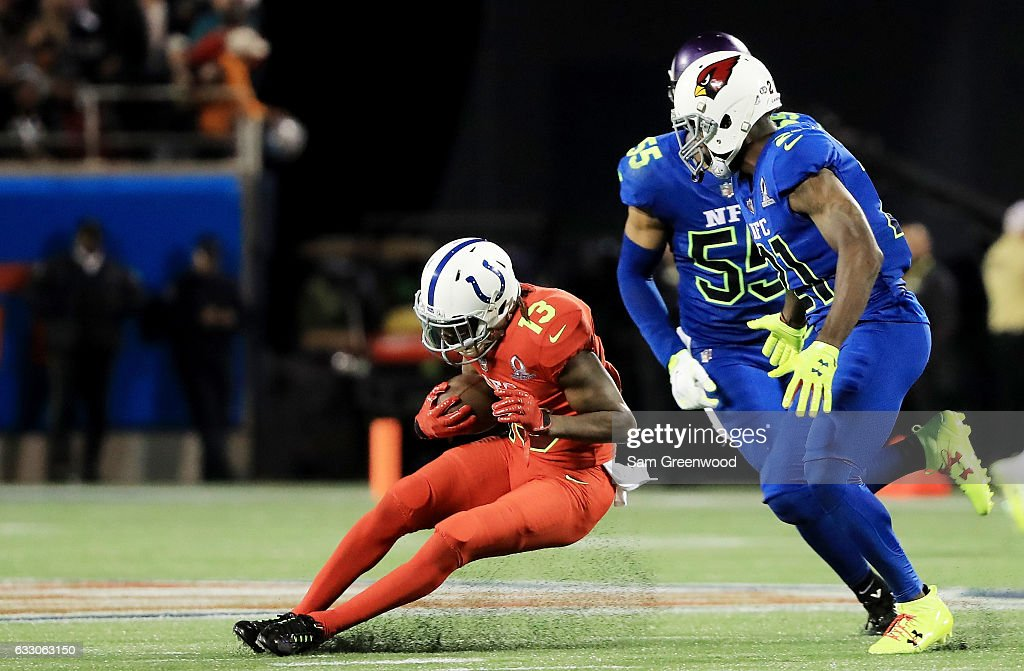 T.Y. Hilton #13 of the AFC slides against the defense of the NFC in the second half during the NFL Pro Bowl at the Orlando Citrus Bowl on January 29, 2017 in Orlando, Florida.