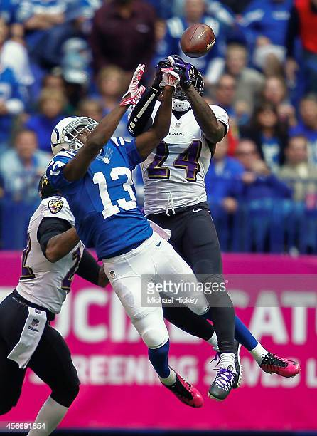 Y Hilton of the Indianapolis Colts and Darian Stewart of the Baltimore Ravens battle for the ball at Lucas Oil Stadium on October 5 2014 in...