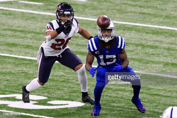 Hilton of the Indianapolis Colts attempts to catch a pass while being defended by Justin Reid of the Houston Texans during the fourth quarter at...