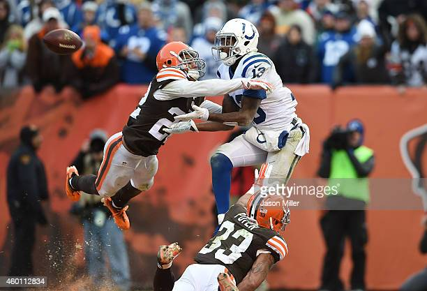 Y Hilton of the Indianapolis Colts can't make a catch between the defense of Buster Skrine and Jordan Poyer of the Cleveland Browns during the fourth...