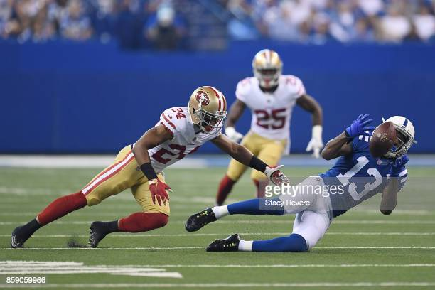Y Hilton of the Indianapolis Colts catches a pass in front of K'Waun Williams of the San Francisco 49ers during the first quarter of a game at Lucas...