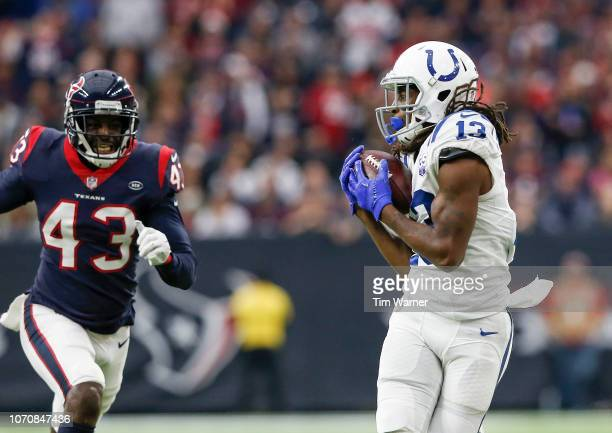 Y Hilton of the Indianapolis Colts catches a pass in the third quarter defended by Shareece Wright of the Houston Texans at NRG Stadium on December 9...