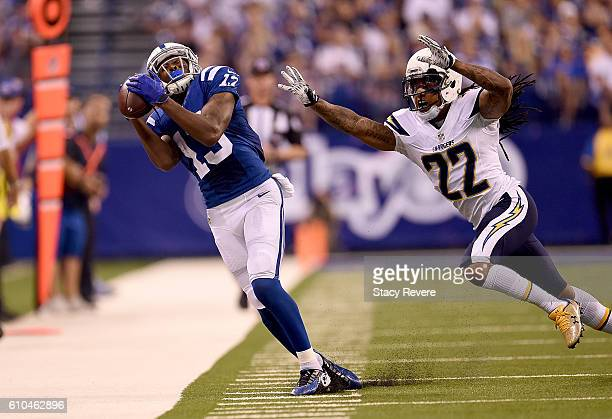Y Hilton of the Indianapolis Colts catches a pass while being covered by Jason Verrett of the San Diego Chargers during the game at Lucas Oil Stadium...