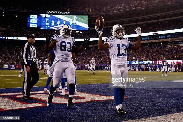 Y Hilton of the Indianapolis Colts celebrates with Dwayne Allen after catching 30 yard touchdown pass thrown by Andrew Luck in the third quarter...