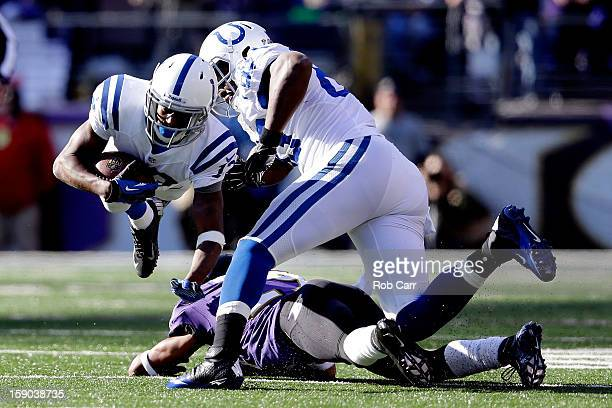Y Hilton of the Indianapolis Colts is tripped up by Cary Williams of the Baltimore Ravens as Hilton ran for yards after the catch in the first half...