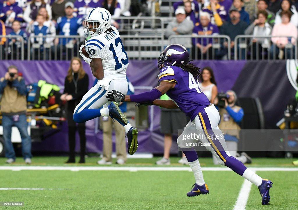 T.Y. Hilton #13 of the Indianapolis Colts leaps to catch the ball in the first quarter of the game against the Minnesota Vikings on December 18, 2016 at US Bank Stadium in Minneapolis, Minnesota.