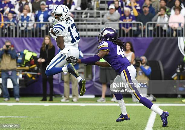 Y Hilton of the Indianapolis Colts leaps to catch the ball in the first quarter of the game against the Minnesota Vikings on December 18 2016 at US...