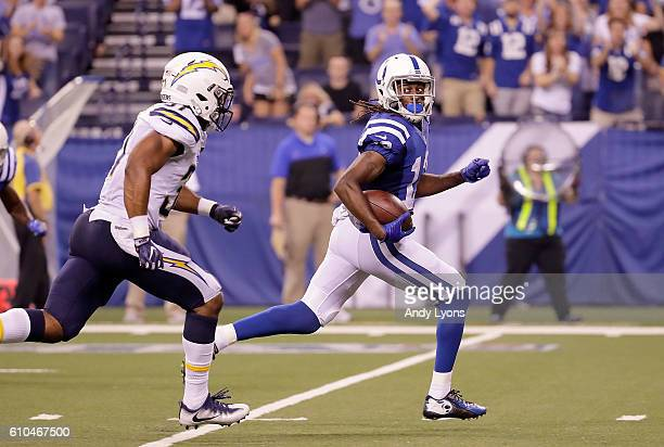 Y Hilton of the Indianapolis Colts looks back at Adrian Phillips of the San Diego Chargers as he runs for 63yard touchdown during the fourth quarter...