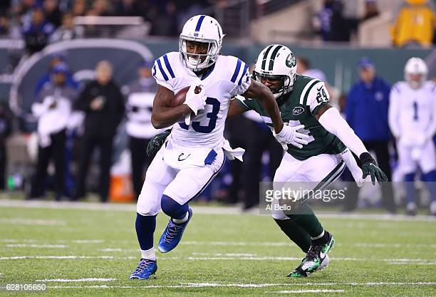 Y Hilton of the Indianapolis Colts runs after a catch and is chased by Darrelle Revis of the New York Jets during their game at MetLife Stadium on...