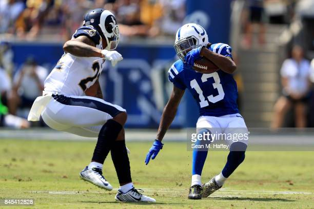 Y Hilton of the Indianapolis Colts runs towards Trumaine Johnson of the Los Angeles Rams during the first half of a game at Los Angeles Memorial...
