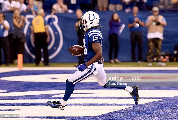 Y Hilton of the Indianapolis Colts scores a game winning 63yard touchdown pass during the game against the San Diego Chargers at Lucas Oil Stadium on...