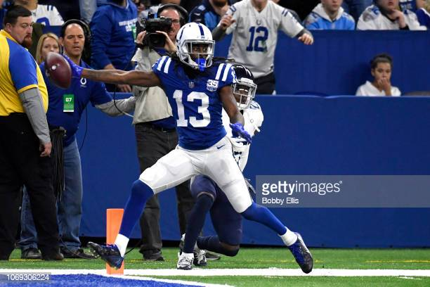 Y Hilton of the Indianapolis Colts scores a touchdown in the game against the Tennessee Titans in the third quarter at Lucas Oil Stadium on November...