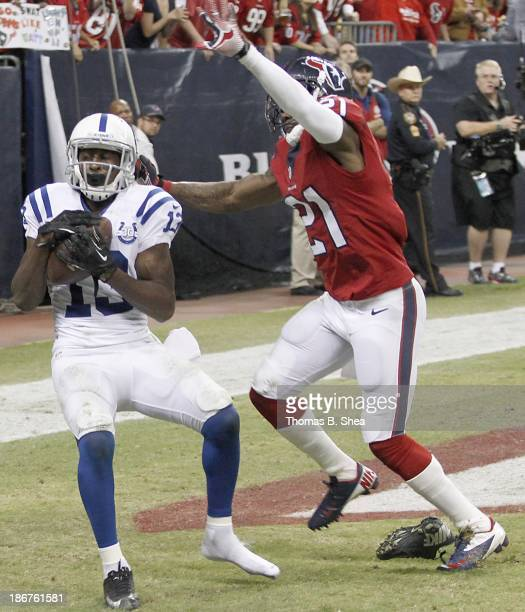 Y Hilton of the Indianapolis Colts scores a touchdown reception while Brice McCain of the Houston Texans defends on November 03 2013 at Reliant...