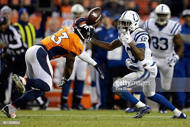 Y Hilton of the Indianapolis Colts tries to make a catch as TJ Ward of the Denver Broncos defends during a 2015 AFC Divisional Playoff game at Sports...