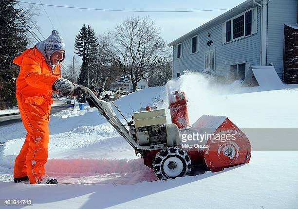 CONTENT] Hilton Shields at the intersection of Matthews Street and Sand Hill Road in Bristol Conn while cleaning up from Winter Storm Hercules on...
