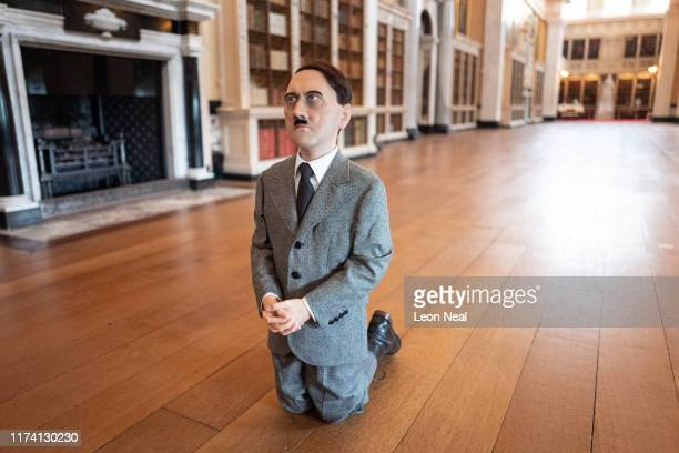 """Him"""", a realistic model of a kneeling schoolboy with the head of Adolf Hitler created by artist Maurizio Cattelan, is seen at Blenheim Palace on..."""
