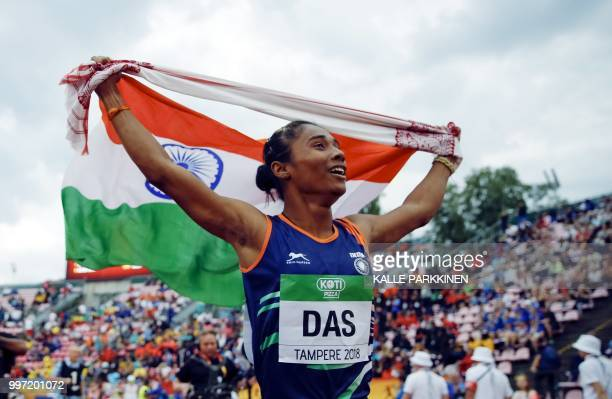 Hima Das of India celebrates her victory in women's 400 metres at the 2018 IAAF World U20 Championships in Tampere Finland on July 12 2018 / Finland...