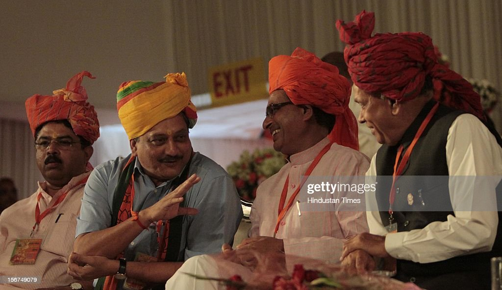 'SURAJKUND, INDIA - SEPTEMBER 27: (R-L) Himachal CM Prem Kumar Dhumal, Madhya Pradesh CM Shivraj Singh Chauhan and Goa CM Manohar Parrikar at the party's National Council meeting at Surajkund on September 27, 2012 in Faridabad, India. (Photo by Sunil Saxena/Hindustan Times via Getty Images)'
