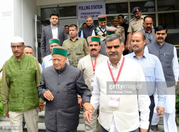 Himachal Pradesh Chief Minister Virbhadra Singh with Congress legislators comes out from the polling station after casting the vote for presidential...