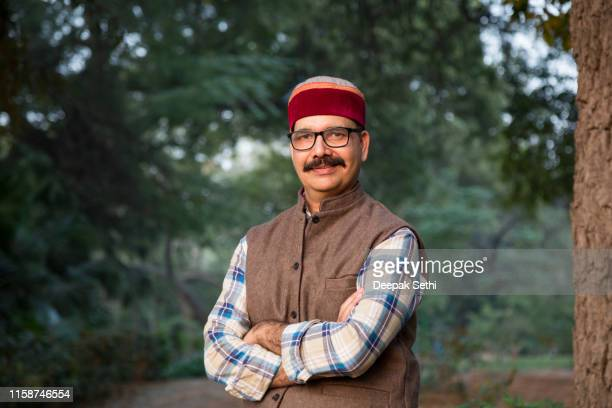 himachal pradesh : mature man - stock images - green coat stock pictures, royalty-free photos & images