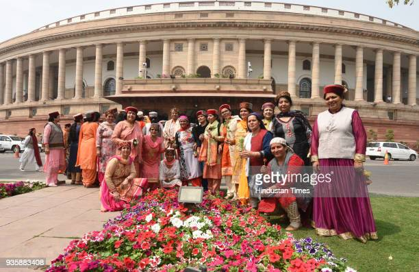 Himachal Pradesh women visitors pose for a photograph during the Parliament Budget Session in New Delhi India on Wednesday March 21 2018