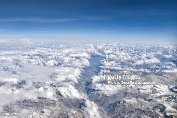 Himalaya mountains under clouds. View from the airplane. India, Ladakh