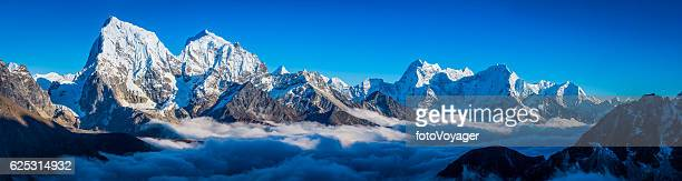 himalayan mountain peaks panorama above the clouds solu khumbu nepal - mountain range stock pictures, royalty-free photos & images