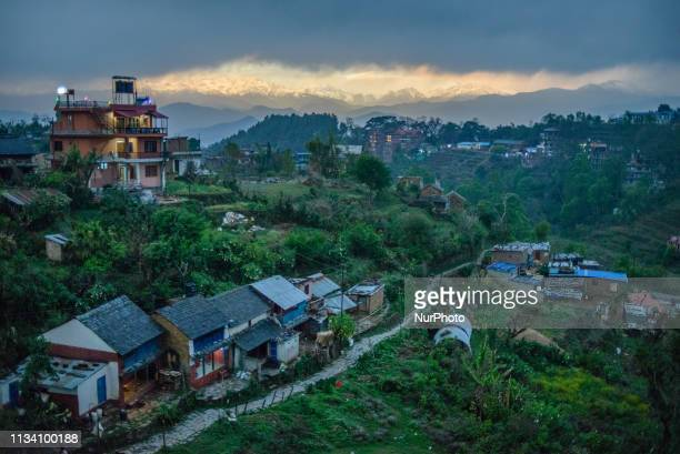 Himalayan mountain range shows behind the storm clouds in Bandipur Nepal on March 31 2019