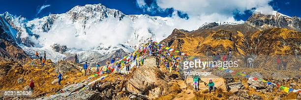 Himalayas crowds of trekkers beside prayer flags at Annapurna Sanctuary