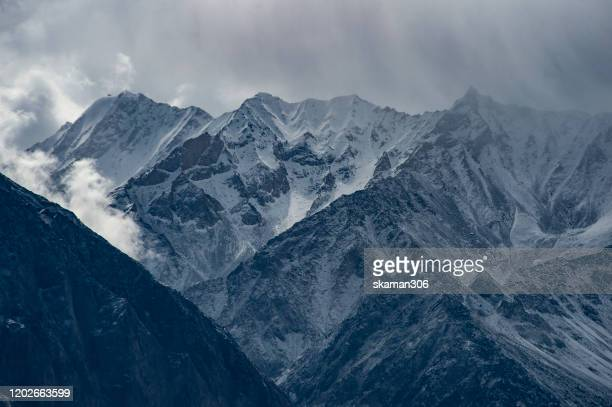 himalayas mountain range with tibetan prayer flag near dingboche on the way to everest basecamp nepal - himalayan salt stock pictures, royalty-free photos & images