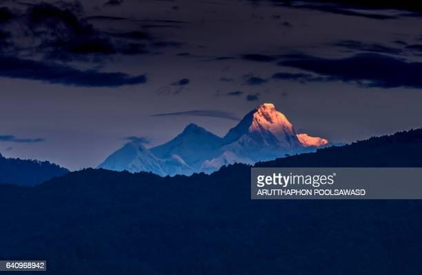 Himalchuli at sunrise time , Himalayas range Mountain nature background landscape cloudy