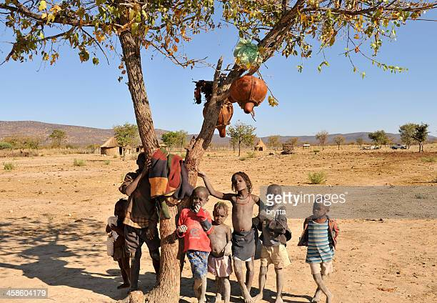 himba children under tree in village near opuwo,namibia - opuwo tribe stock photos and pictures