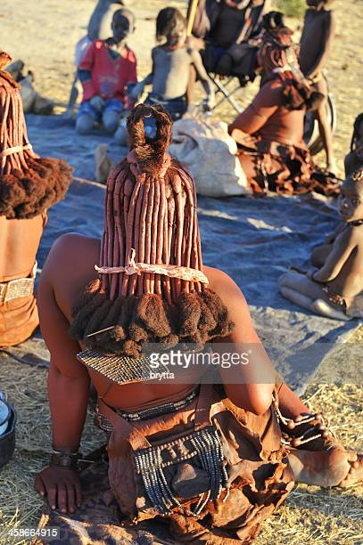 himba family sitting together in village near opuwo,namibia - opuwo tribe stock photos and pictures