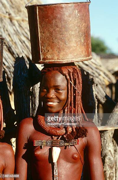 Himba Girl Carrying Pail Namibia Africa
