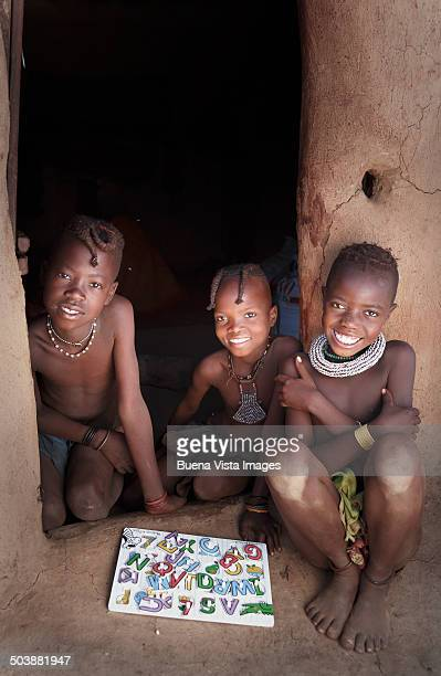 Himba girls with spelling book