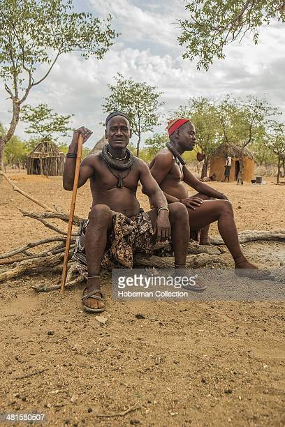 Himba Men Sitting Outside A Hut Doing Nothing But Discussing Politics in a Village Near Opuwo