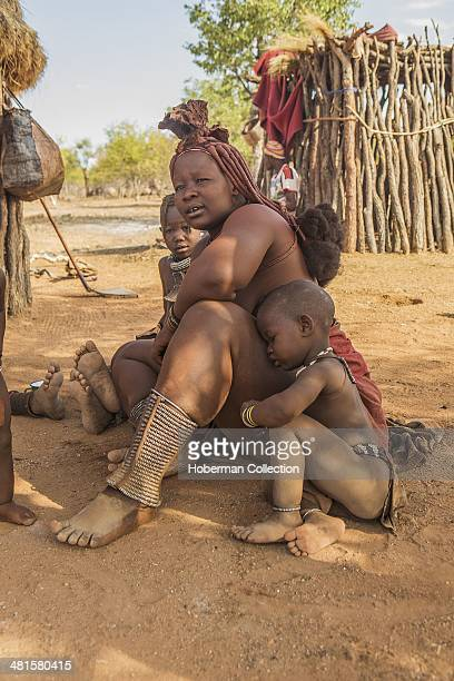 Himba Mother With Braided Red Hair And Her Boy In Their Traditional Village
